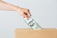 100-dollar-bill-being-put-into-box