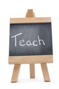 Teach written on blackboard