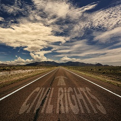 civil rights road into mountains with words on it