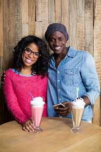 teen young adults with milkshakes