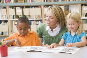 Teacher with young students reading image