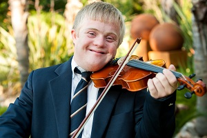 teenager with Down syndrome playing violin